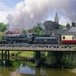 Branch-line beauty: Preserved British Railways 'Standard' class 2-6-0 No. 76079 crosses a bridge over the River Esk at Ruswarp, North Yorkshire, in June 2009. The 36-mile single-track line to Whitby traverses England's green and pleasant land at its most glorious