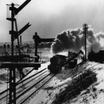 Journey's end: An ex-LNER 'V2' mixed traffic engine restarts from a signal check at Chester-le-Street, Co. Durham, with a northbound train in February 1963, the year the station was slated for closure by Beeching.