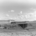 High drama: A 'Black Five' and a 'Jubilee' double-head the Waverley express over the Ribblehead viaduct, c1958. The picture is by Eric Treacy, Bishop of Wakefield, one of the line's most devoted enthusiasts.