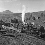 My heart's in the Highlands: 'Standard Class 5' No. 73078 and ex-LMS 'Black Five' No. 44976 take water at Crianlarich with the 2.56pm restaurant car train from Fort William to Glasgow in May 1959.
