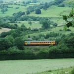 Little train, big journey: A single-carriage Class 153 unit meanders through Knucklas on its way from Shrewsbury to Swansea in May 2009. The service may be sparse, but it is one of the great railway journeys of the world.